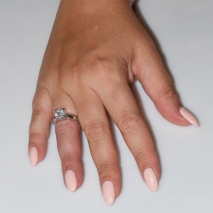 Handmade wedding ring with sterling silver platinum plating and precious stones (zircon) IJ-010482-S worn in hand